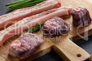 Sirloin chops and beef steak on wooden board