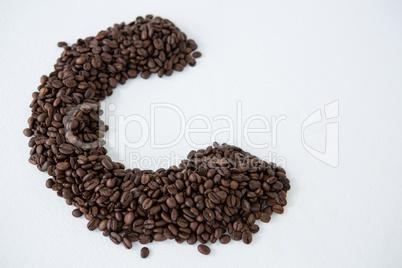 Coffee beans forming alphabet C