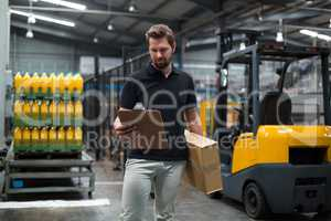 Factory staff looking at clipboard