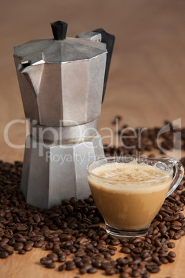 Coffee beans with metallic coffee maker and coffee cup