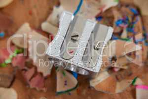 Sharpener and various colored pencil shavings