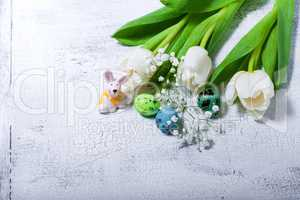 Bunny, eggs and white flowers Easter symbols