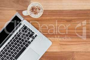 Mug of coffee and laptop