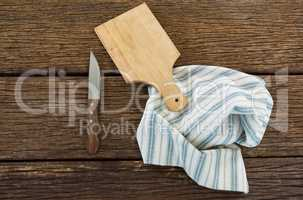Knife, wooden tray and table cloth