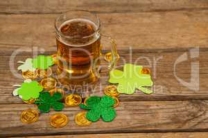 Mug of beer, chocolate gold coins and shamrock for St Patricks Day