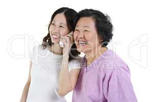 Daughter and mother calling on phone