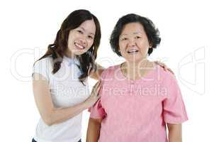 Asian senior mother and adult daughter smiling