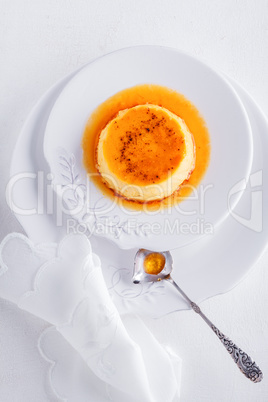 Creme Caramel on a plate served on a table