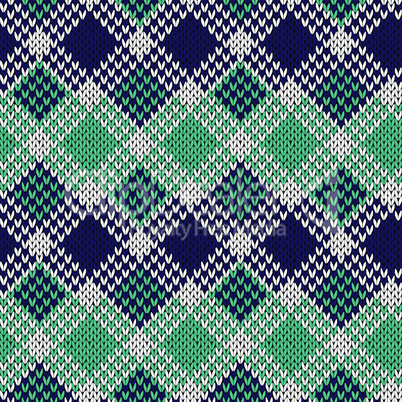 Seamless knitted pattern in blue, turquoise and white colors