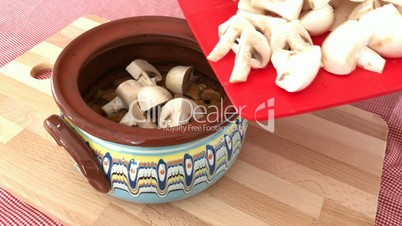 Preparing meal with meat and mushrooms