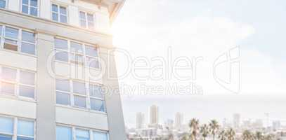 Composite image of modern building against clear blue sky