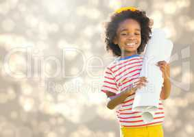 Happy Kid Boy holding paper against shining background
