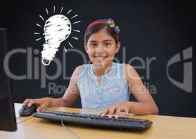 kid and blackboard with lightbulb using computer against a black background
