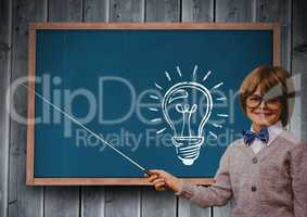 Composite image of intellectual kid against blackboard with lightbulb