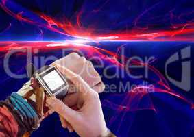 Composite image of Hand adjusting Smart Watch against light effects