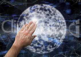 Composite image of Hand touching bright globe against graphic effects