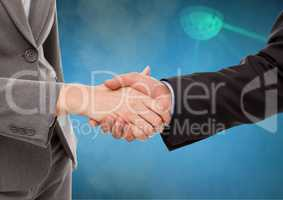 Businessmen Shaking Hands against a Light Blue Ray background
