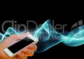 Composite image of Hand holding cell phone against smoke effects