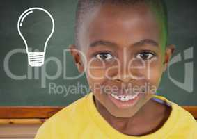 Composite image of kid smiling against blackboard with lightbulb