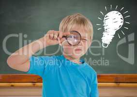 Composite image of kid looking through magnifiying glass against blackboard with lightbulb