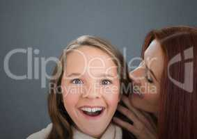 Mother and Daughter Smilling against a grey background