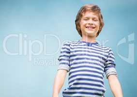 Kid Boy smiling at camera against blue background