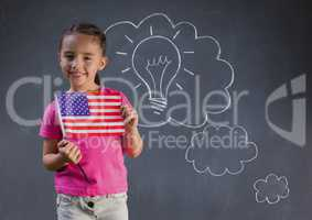 Composite image of smiling girl with a little american flag against blackboard with lightbulb and cl