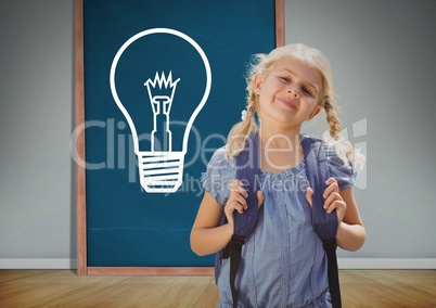 kid and blue blackboard with lightbulb against a grey background