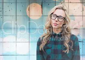 Woman with glasses against tiles with bokeh background