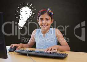 Composite image of Smiling girl in front of a computer against blackboard with lightbulb