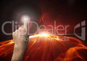 Composite image of Hand touching light against flames