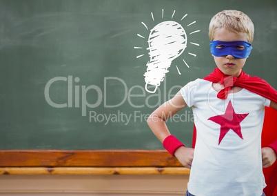 Composite image of superhero kid against blackboard with lightbulb