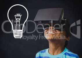 Composite image of kid wearing helmet against blackboard with lightbulb