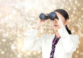 Businesswoman using binoculars against Sparkles light background