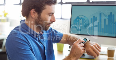 Graphic designer adjusting smart watch