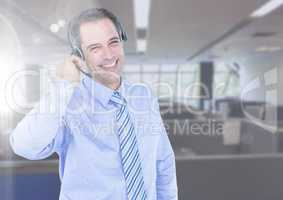 Cheerful customer service man in headset