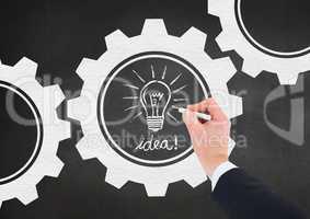 Man drawing electric bulb on blackboard