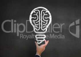 Businessman hand holding electric bulb against black background
