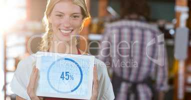 Portrait of smiling executive showing graph chart on digital tablet