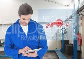 Mechanic using digital tablet against digital interface at workshop