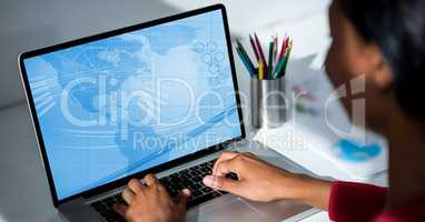 Executive using computer at desk