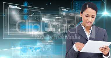 Digital composite image of a businesswoman using digital tablet