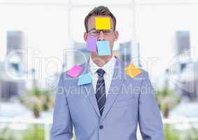 Sticky notes stuck on businessman