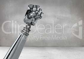 Fist of a robot against grey background