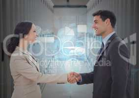 Businessman and woman shaking hands each other in office corridor