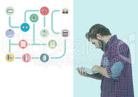 Man using digital tablet and various applications icon