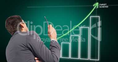 Digital composite image of businessman with business plan graph