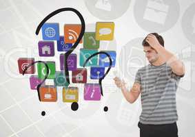 Confused man using mobile phone with various applications