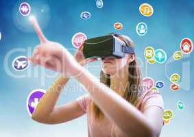 Woman using virtual reality headset with digitally generated icons