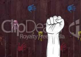 Fist hand against wooden background